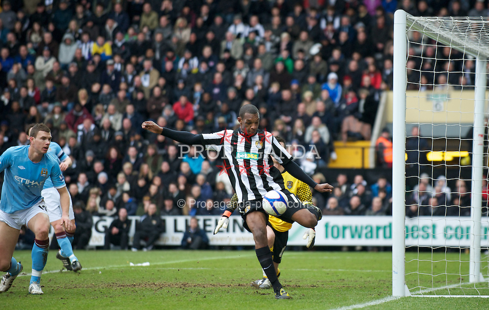 NOTTINGHAM, ENGLAND - Sunday, January 30, 2011: Manchester City's Edin Dzeko sees his shot cleared off the line by Notts County's Krystian Pearce during the FA Cup 4th Round match at Meadow Lane. (Photo by David Rawcliffe/Propaganda)
