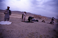 01 September 2005..On the way back to Kabul, the bus driver stop the vehicle to let the passengers to perform Salah. In accordance with Sunnah, it is the resposability of every Muslim to pray five times a day. SALAH is a pillar of DIN