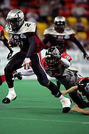 6-28-2007: Anchorage, AK - Alaska's Demarcus Morris (2) makes a cut past Barracuda Kyle Robinson (4) but is caught from behind by Quentin Lankford (5) in the Alaska Wild 47 to 53 loss to the CenTex Barracudas at the Sullivan Arena...
