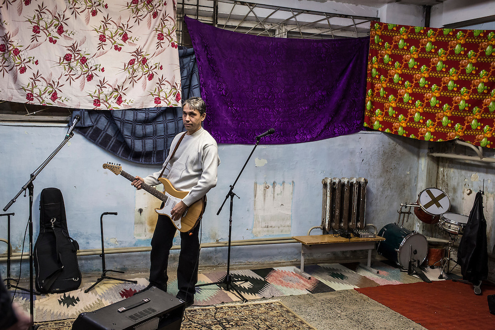Valery Shekin of the band Hammer and Sickle rehearses in the basement of a local school on Tuesday, November 12, 2013 in Asbest, Russia.