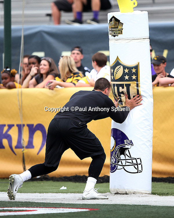 Pittsburgh Steelers quarterback Landry Jones (3) hits the goal post pad while warming up before the 2015 NFL Pro Football Hall of Fame preseason football game against the Minnesota Vikings on Sunday, Aug. 9, 2015 in Canton, Ohio. The Vikings won the game 14-3. (©Paul Anthony Spinelli)