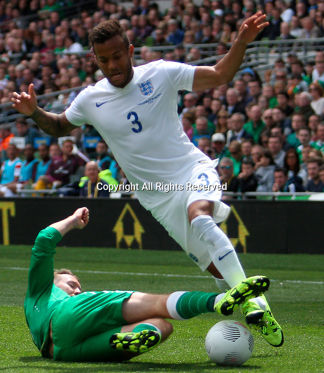 07.06.2015.  Dublin, Ireland. International Football Friendly. Republic of Ireland versus England. Aiden McGeady (Rep. of Ireland) slides in to take the ball off Ryan Bertrand (England).