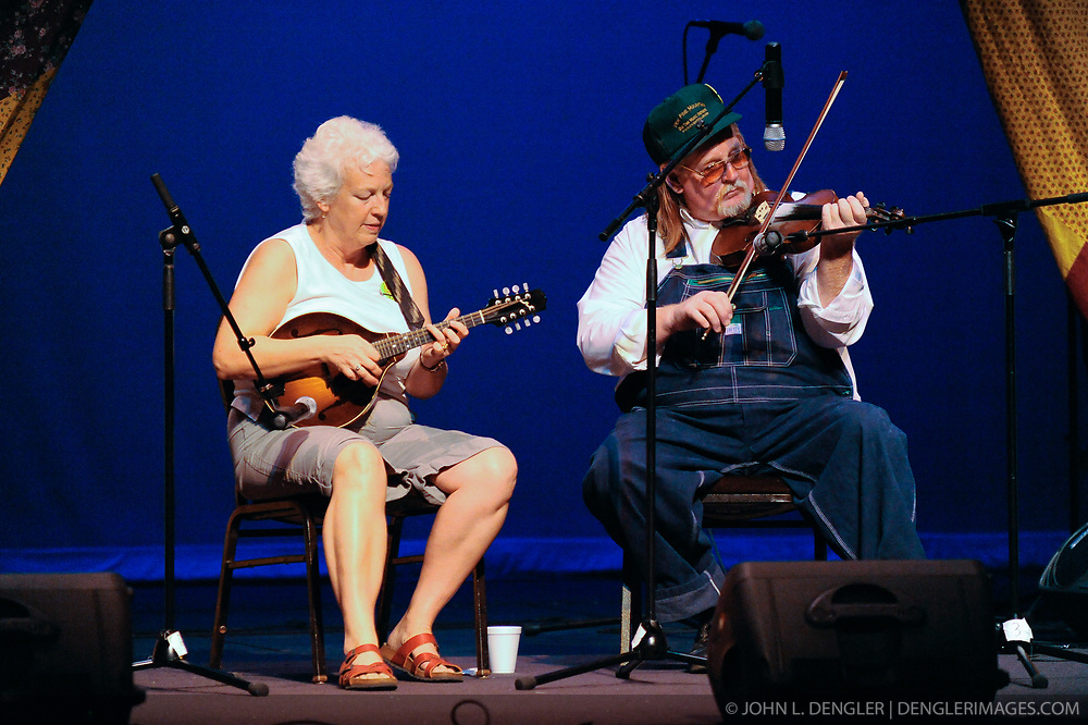 Ruth Ann Randall of Frederick, Maryland and John Morris of Clay County, West Virginia, perform in the West Virginia State Theater during the 2009 Vandalia Gathering.