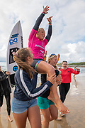 Yolanda Hopkins (PRT), carried aloft by supporters as she is crowned Women's Longboard Pro Champion, Boardmasters 2019 at Fistral Beach, Newquay, Cornwall, United Kingdom on 11 August 2019.