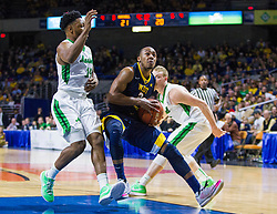 Dec 17, 2015; Charleston, WV, USA; West Virginia Mountaineers guard Jevon Carter (2) drives down the lane while being guarded by Marshall Thundering Herd guard C.J. Burks (14) during the first half at the Charleston Civic Center . Mandatory Credit: Ben Queen-USA TODAY Sports