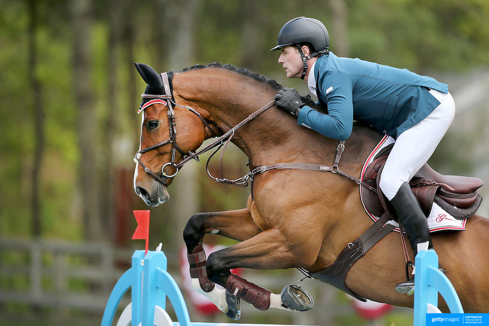 NORTH SALEM, NEW YORK - May 15: Peter Lutz, USA, riding Retiro, in action during The $50,000 Old Salem Farm Grand Prix presented by The Kincade Group at the Old Salem Farm Spring Horse Show on May 15, 2016 in North Salem. (Photo by Tim Clayton/Corbis via Getty Images)