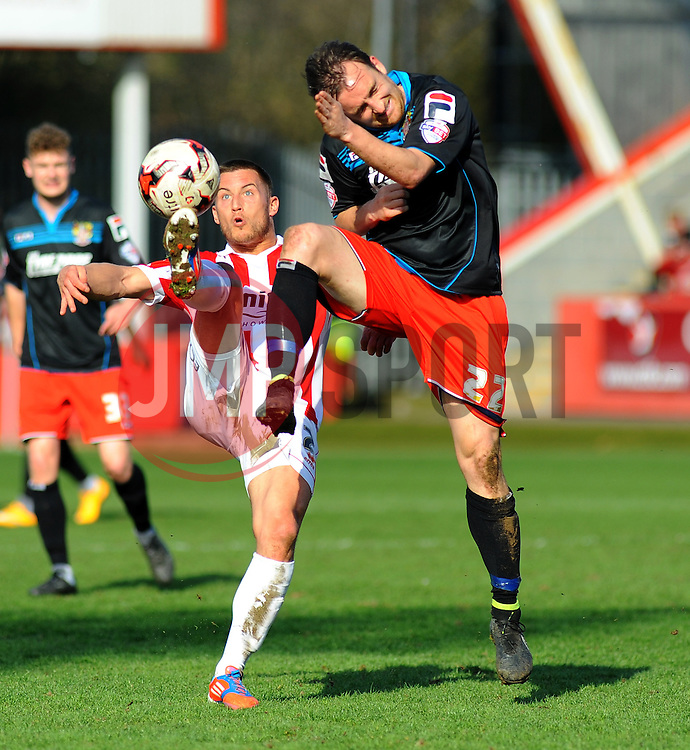 Stevenage's Charlie Lee and Cheltenham Town's Lee Vaughan battle for the ball - Photo mandatory by-line: Nizaam Jones - Mobile: 07966 386802 - 06/04/2015 - SPORT - Football - Cheltenham - Whaddon Road - Cheltenham Town v Stevenage - Sky Bet League Two