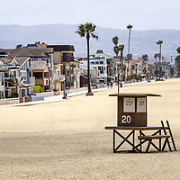 Newport Beach waterfront luxury homes and lifeguard stand on Balboa Peninsula. Newport Beach is an upscale beach city in affluent Orange County in Southern California in the United States. Photo is high resolution and was taken in 2012.