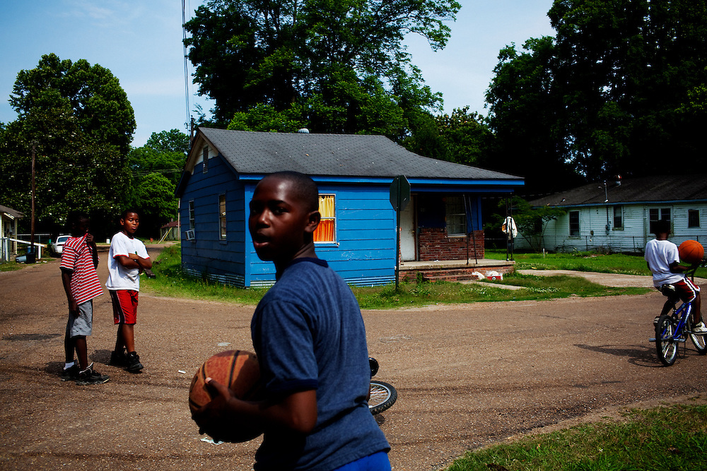 (L-R) Jonathan Charles Edwards, 9, Rick Russell, 10, Tray Whitaker, 11, and Jaelin Wilson, playing in Baptist Town, Mississippi on Wednesday, May 19, 2010.