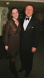 MISS GISELE ROMAN and MR RICCARDO MAZZUCCHELLI former husband of Ivana Trump,  at a dinner in London on 23rd February 1999.MOR 4