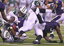 Sept 13, 2011; East Rutherford, NJ, USA; Baltimore Ravens running back Jalen Parmele (34) is tackled by New York Jets cornerback Marquice Cole (34) and New York Jets running back Danny Woodhead (27) during the second half at the New Meadowlands Stadium.  The Ravens defeated the Jets 10-9.