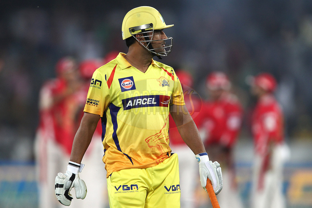 Chennai Super Kings captain MS Dhoni walks back to the dug out after getting out first ball to Parvinder Awana of the Kings XI Punjab during the second semi final match of the Oppo Champions League Twenty20 between the Kings XI Punjab and the Chennai Superkings held at the Rajiv Gandhi Cricket Stadium, Hyderabad, India on the 2nd October 2014<br /> <br /> Photo by:  Shaun Roy / Sportzpics/ CLT20<br /> <br /> <br /> Image use is subject to the terms and conditions as laid out by the BCCI/ CLT20.  The terms and conditions can be downloaded here:<br /> <br /> http://sportzpics.photoshelter.com/gallery/CLT20-Image-Terms-and-Conditions-2014/G0000IfNJn535VPU/C0000QhhKadWcjYs