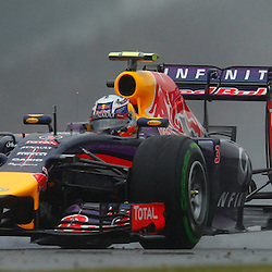 FORMULA 1 SANTANDER BRITISH GRAND PRIX .. Daniel Ricciardo in the wet third free practice session...(c) STEPHEN LAWSON | SportPix.org.uk
