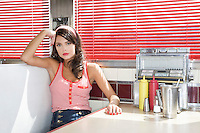 Young Woman in a Diner Booth