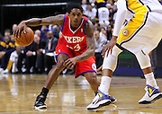 April 21, 2012; Indianapolis, IN, USA; Philadelphia 76ers point guard Lou Williams (23) dribbles in the backcourt against the Indiana Pacers at Bankers Life Fieldhouse. Philadelphia defeated Indiana 109-106. Mandatory credit: Michael Hickey-US PRESSWIRE