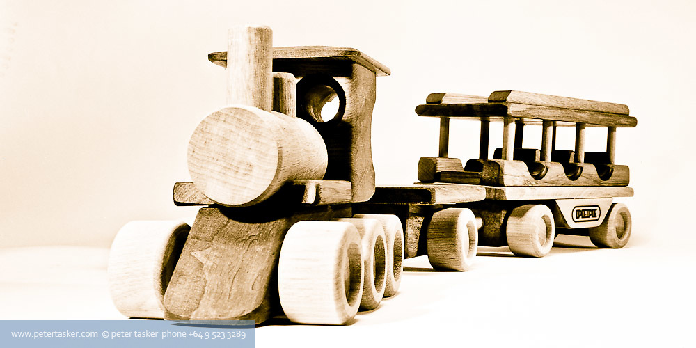 Train and carriage. One of a range of wooden toys designed and manufactured by Peter Tasker in the 1970s.