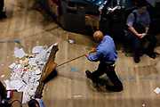 Manhattan, New York, USA, 20081010:   The Wall Street is still jittery. NYSE New York Stock Exchange on the last day of the worst week ever for the Dow Jones index. Janitor sweeping the floor after the closing bell. Photo: Orjan F. Ellingvag/ Dagens Naringsliv