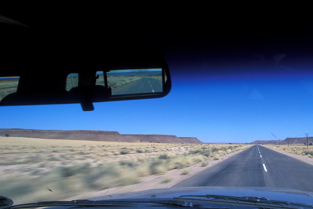 Africa, Namibia,  Blurred image through windshield of truck driving through Namib Desert east of Keetmanshoop