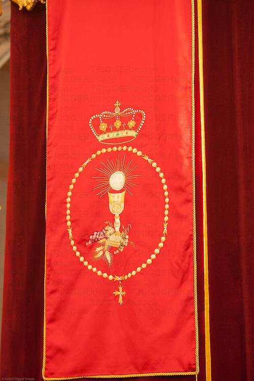 Eucharistic symbols on a banner, San Martin church, Carrion de los Cespedes, Seville, Spain