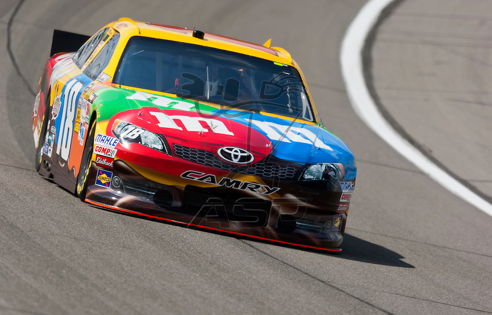 KANSAS CITY, KS - APR 20, 2012:  Kyle Busch (18) brings his car through the turns during a practice session for the STP 400 at the Kansas Speedway in Kansas City, KS.
