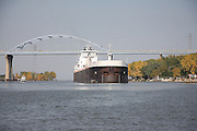 On an autumn afternoon in 2008, this large coal freighter has cleared the Leo Frigo Memorial Bridge and slowly heads upstream and into the Port of Green Bay.