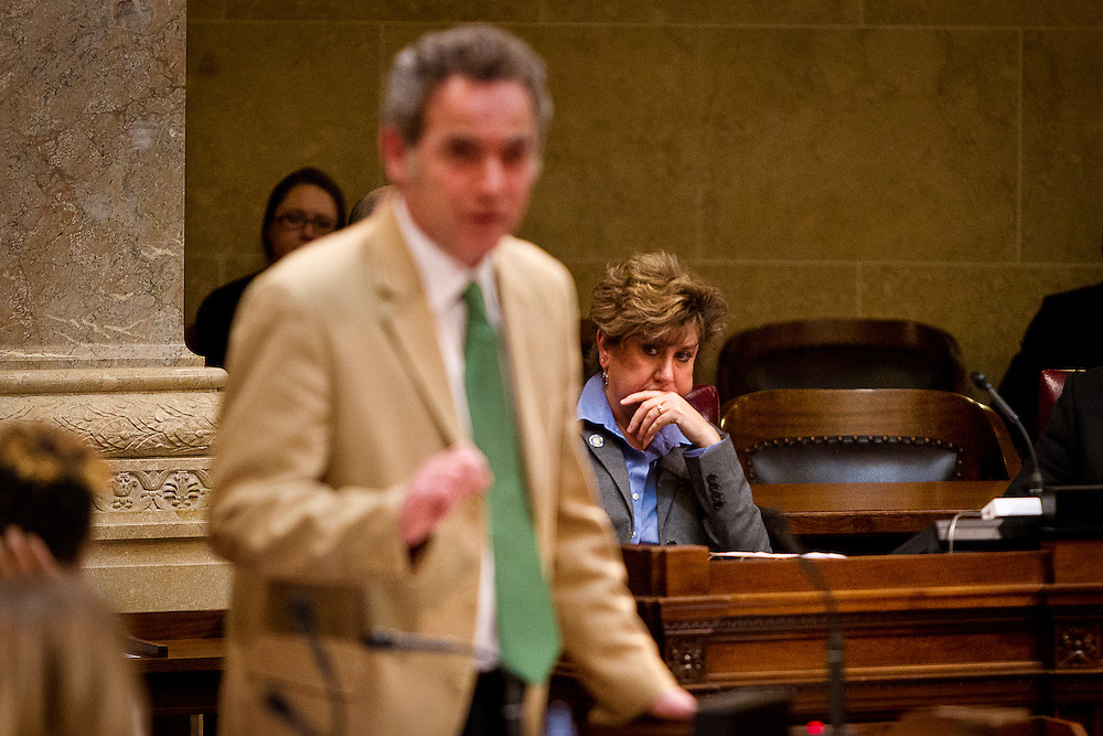 MADISON, WI — FEBRUARY 25: State Senator Jennifer Shilling, right, looks on as Senator Jon Erpenbach speaks during a State hearing regarding the controversial right-to-work Senate Bill 44.