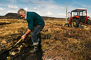 One of the last countrymen collecting peat in the countryside near Ardara.
