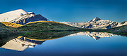 Mt Aspiring reflection in tarn, Cascade Saddle, Mount Aspiring National Park, Otago, New Zealand.