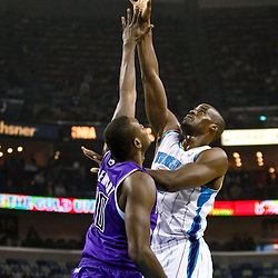 December 15, 2010; New Orleans Hornets center Emeka Okafor (50) shoots over Sacramento Kings center Samuel Dalembert (10) during the first half at the New Orleans Arena.  Mandatory Credit: Derick E. Hingle