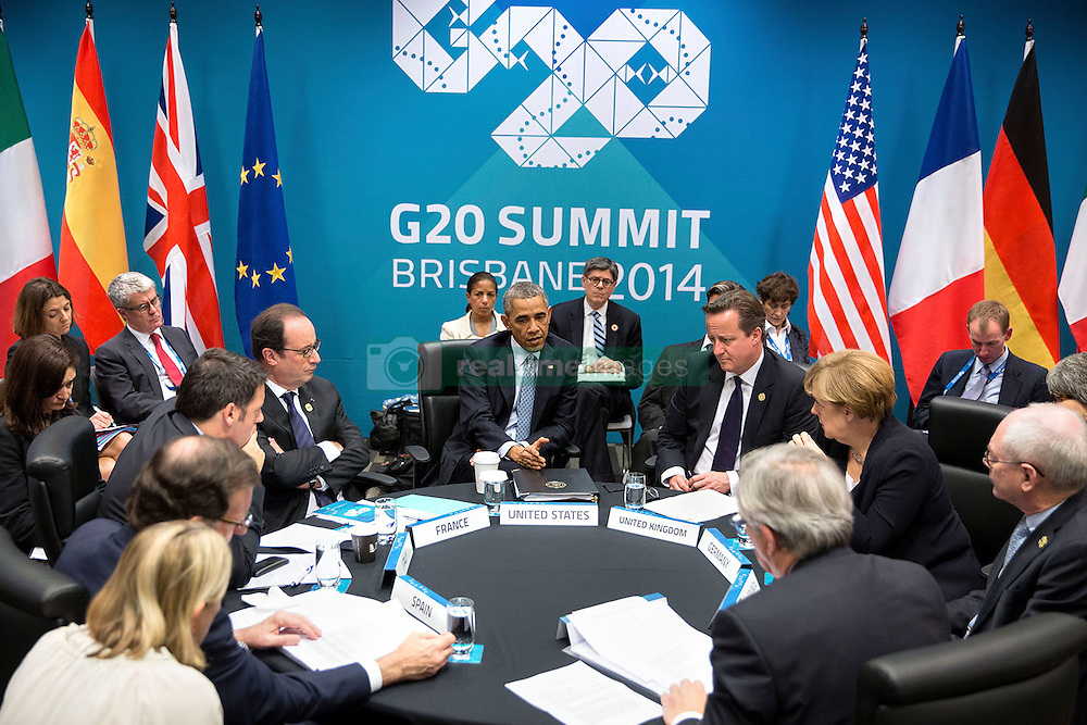 President Barack Obama attends the G20 European Leaders Meeting on the Transatlantic Trade and Investment Partnership and Ukraine at the Brisbane Convention and Exhibition Center, Brisbane, Queensland, Australia, Nov. 16, 2014. Seated clockwise from the President are: Prime Minister David Cameron of the United Kingdom; Chancellor Angela Merkel of Germany; Herman Van Rompuy, President of the European Council;  Jean-Claude Juncker, President of the European Commission; Prime Minister Mariano Rajoy Brey of Spain; Prime Minister Matteo Renzi of Italy and President Fran&ccedil;ois Hollande of France. (Official White House Photo by Pete Souza)<br /> <br /> This official White House photograph is being made available only for publication by news organizations and/or for personal use printing by the subject(s) of the photograph. The photograph may not be manipulated in any way and may not be used in commercial or political materials, advertisements, emails, products, promotions that in any way suggests approval or endorsement of the President, the First Family, or the White House.