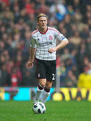 MANCHESTER, ENGLAND - Sunday, September 19, 2010: Liverpool's Christian Poulsen in action against Manchester United during the Premiership match at Old Trafford. (Photo by David Rawcliffe/Propaganda)