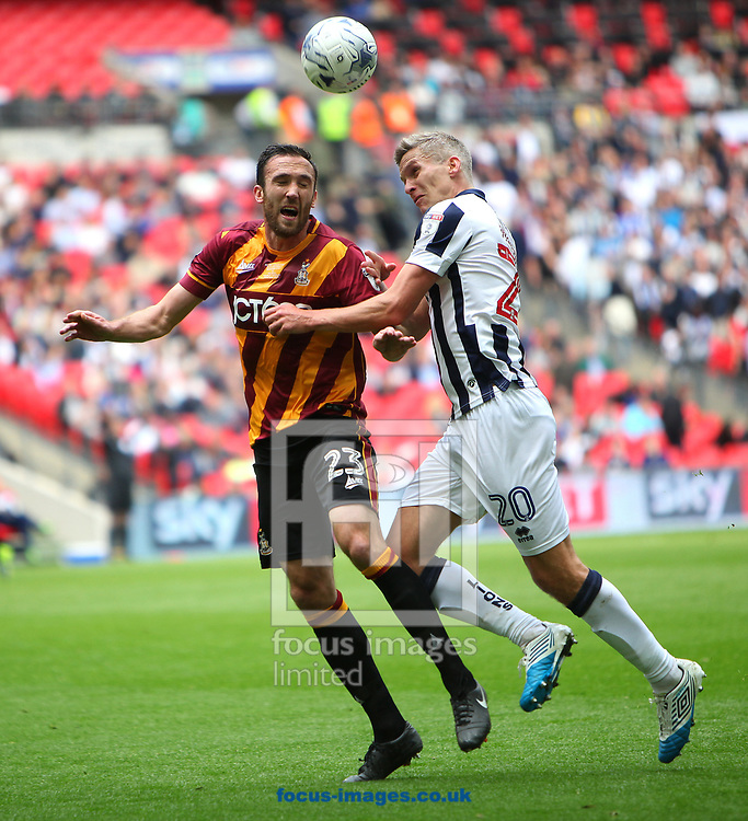 Millwall forward Steve Morison battles with Bradford City's McArdle during the Sky Bet League 1 play-off final at Wembley Stadium, London<br /> Picture by Glenn Sparkes/Focus Images Ltd 07939664067<br /> 20/05/2017