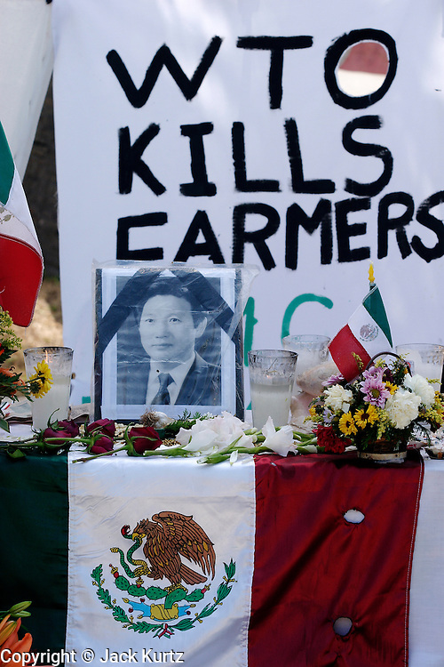 14 SEPTEMBER 2003 - CANCUN, QUINTANA ROO, MEXICO:  A shrine dedicated to Lee Kyung-hae, a Korean farm activists who publicly committed suicide Wednesday in Cancun to protest World Trade Organization agricultural policies, has been built where he died in a park in Cancun. Thousands of protestors opposed to the World Trade Organization and globalization have come to Cancun to protest the WTO meetings taking place in the hotel zone. Mexican police restricted most of the anti-globalization protestors to downtown Cancun, about five miles from the convention center.  PHOTO BY JACK KURTZ / THE IMAGE WORKS