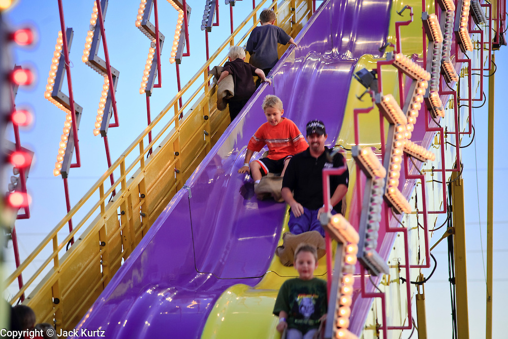 14 OCTOBER 2008  -- PHOENIX, AZ: The giant slide at the Arizona State Fair. The Arizona State Fair started Oct.  10 and runs through Nov. 2. Carnival and midway workers who have worked the fair for years say attendance so far is much lower than in the past and people at the fair this year aren't spending as much money as they have in the past. PHOTO BY JACK KURTZ