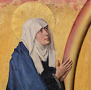 The Virgin Mary in worship before Christ as Supreme Judge on Judgement Day, from the open panels of the polyptych altarpiece, 1446-52, by Rogier van der Weyden, 1399-1464, commissioned by Nicolas Rolin in 1443, in Les Hospices de Beaune, or Hotel-Dieu de Beaune, a charitable almshouse and hospital for the poor, built 1443-57 by Flemish architect Jacques Wiscrer, and founded by Nicolas Rolin, chancellor of Burgundy, and his wife Guigone de Salins, in Beaune, Cote d'Or, Burgundy, France. The altarpiece was originally in the Chapel, but is now in the museum. The panels were only opened to patients during holy days. The hospital was run by the nuns of the order of Les Soeurs Hospitalieres de Beaune, and remained a hospital until the 1970s. The building now houses the Musee de l'Histoire de la Medecine, or Museum of the History of Medicine, and is listed as a historic monument. Picture by Manuel Cohen
