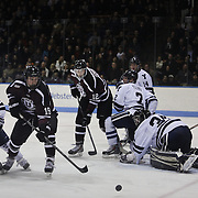 Matt Wilkins, Union College, (centre), in action during the Yale Vs Union College, Men's College Ice Hockey game at Ingalls Rink, New Haven, Connecticut, USA. 28th February 2014. Photo Tim Clayton
