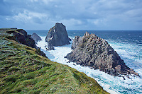 Crashing waves carve the unique coastline of Maline Head, Irelands northern most point. Ireland