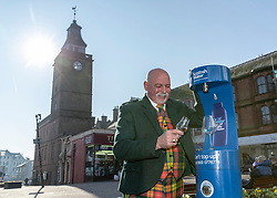 Youngsters paid tribute to one of Dumfries&rsquo; most celebrated former residents when they unveiled a new water refill tap in the town.<br /> <br /> The high tech Top Up Tap has been installed by Scottish Water as part of its national initiative to encourage people to carry a reusable bottle and stay hydrated on the go. <br /> <br /> Pictured: Brian Gibson from one of the town&rsquo;s oldest businesses, whisky and wine specialists TH Watson. The experts, who run the area&rsquo;s Drambusters Whisky Club, sampled water from the new tap.