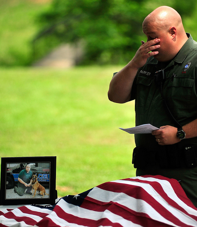 Officer Jay Parker is overcome with emotion as he talks about his former K-9 partner, Ayak, during a memorial service for Ayak at Curry Creek Park in Jefferson, Ga. on Friday, June 6, 2010.  The K-9 officer was found dead in Parkers home on Thursday, May 27, 2010 of unknown causes.  .