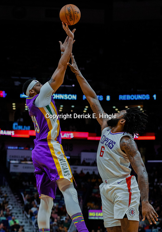 Jan 28, 2018; New Orleans, LA, USA; New Orleans Pelicans forward Anthony Davis (23) shoots over LA Clippers center DeAndre Jordan (6) during the third quarter at the Smoothie King Center. The Clippers defeated the Pelicans 112-103. Mandatory Credit: Derick E. Hingle-USA TODAY Sports