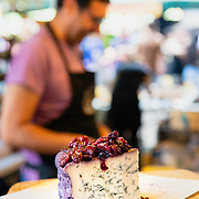 Cheese stall vendor at Borough Market, London