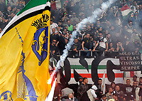 Un fumogeno viene lanciato sui tifosi della Juventus<br /> Fireworks thrown on Juventus supporters.  Before the match, Torino fans attacked the Juventus bus breaking a window<br /> Torino 26-04-2015, Stadio Olimpico, Football Calcio 2014/2015 Serie A TIM, Torino - Juventus, Foto Insidefoto
