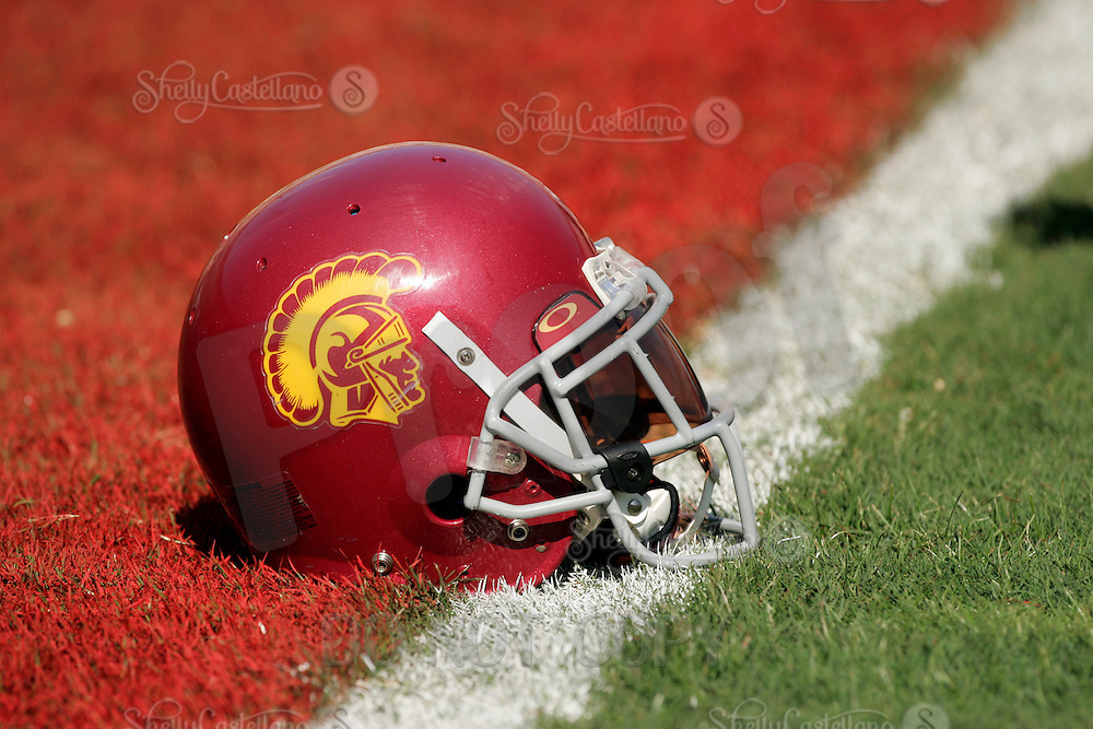 29 October 2005: USC Trojan Helmet on the goal line, product of the USC Trojans 55-13 win over the Washington State Cougars at the Los Angeles Memorial Coliseum, CA. Pac-10 College Football. Detail, art, graphic, sport, grass, painted, visor, helmet.
