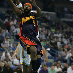 Baron Davis #5 of the Golden State Warriors drives past Morris Peterson #9 of the New Orleans Hornets in the first quarter of their NBA game on April 6, 2008 at the New Orleans Arena in New Orleans, Louisiana.