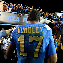 UCLA quarterback Brett Hundley walks-off the field after defeating Southern California 38-20 during a NCAA college football game at the Rose Bowl in Pasadena, Calif., Saturday, Nov. 22, 2014.