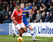 Swindon defender Nathan Thompson holds off Gillingham forward Rory Donnelly during the Sky Bet League 1 match between Gillingham and Swindon Town at the MEMS Priestfield Stadium, Gillingham, England on 6 February 2016. Photo by David Charbit.
