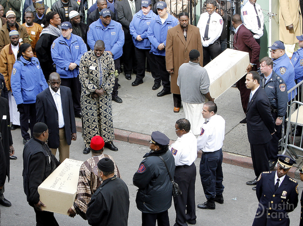 The coffins of two of the children killed in a recent house fire, which took 10 lives in total,  is carried into the Islamic Cultural Center in the Bronx, New York on Monday 12 March 2007. Of the ten people killed in the fire, 9 were children, and all were immigrants from Mali.