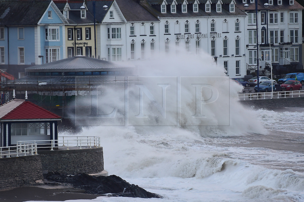 © London News Pictures. 13/11/2015. Aberystwyth Wales UK. At first light and high tide  on Friday the 13th, Storm Abigail continues to batter the seafront  with huge waves at Aberystwyth  on the west wales coast. Photo credit: Keith Morris/LNP