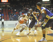 """Ole Miss guard Chris Warren (12)  dribbles against Alcorn State's Kendrick McDonald (0) at the C.M. """"Tad"""" Smith Coliseum in Oxford, Miss. on Thursday, December 29, 2010. Ole Miss won 100-62. (AP Photo/Oxford Eagle, Bruce Newman)"""