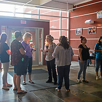 Parents gather and talk inside the Student Support Center, Thursday Aug. 2, after finding out the meeting with officals of Gallup-McKinley County Schools was cancelled.